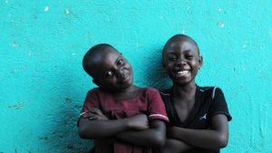 iamsomeone-kids-laughing-teal-bg-1920x1080