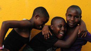 iamsomeone-kids-laughing-yellow-bg-1920x1080